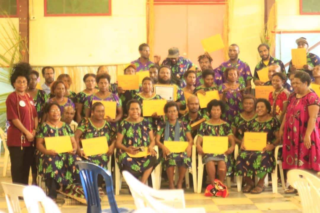 CEFI Head Trainer Jill Pijui (standing far left) with graduating participants of the MSME Financial Literacy and Business Essential Skills Training.