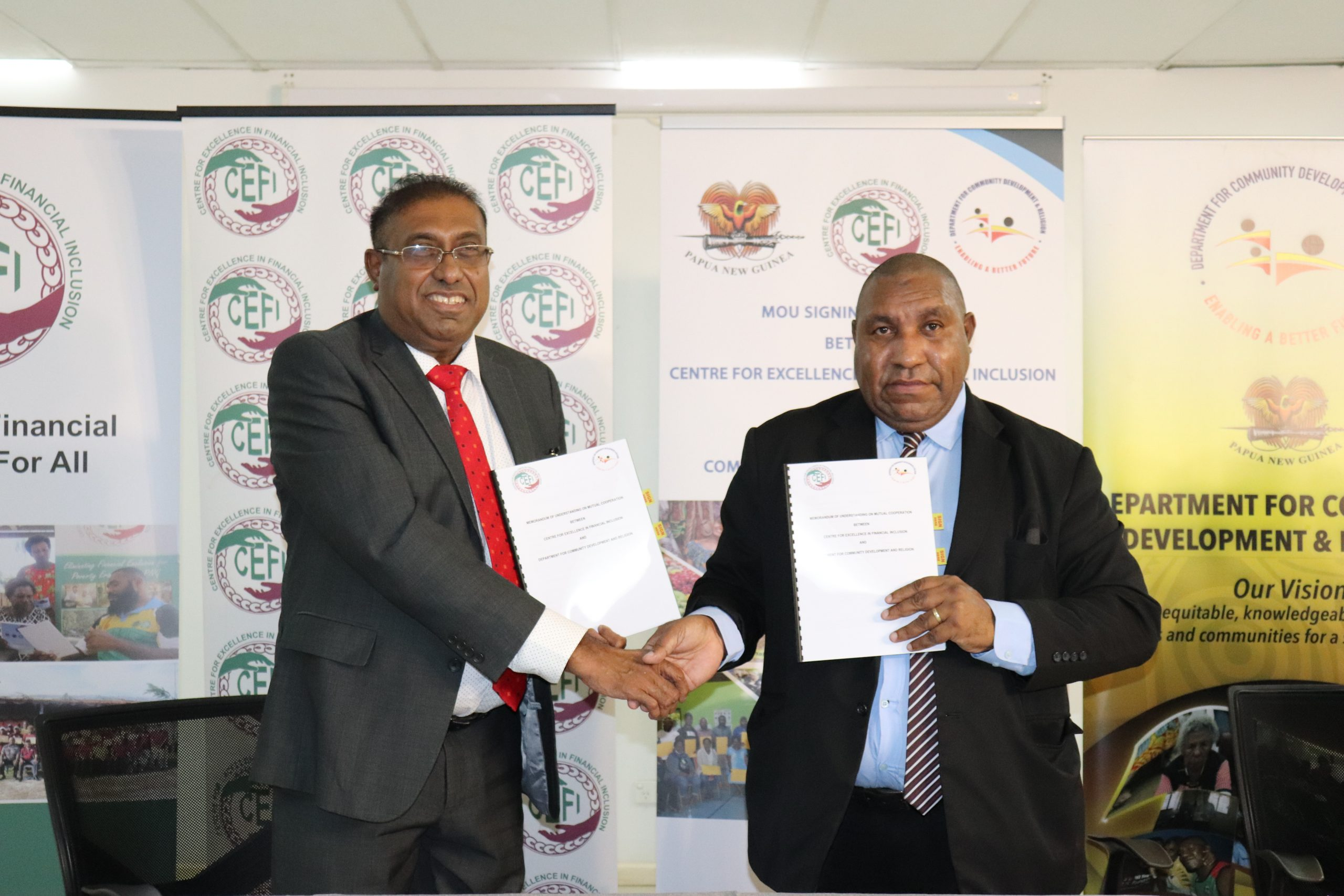 Acting Department Secretary, Mr Jerry Ubase and Executive Director for CEFI, Mr Saliya Ranasinghe shaking hands following the signing of the MoU.